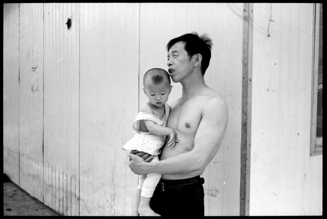 Migrant Miner from Cichuan with Son